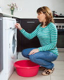 Adult woman doing laundry