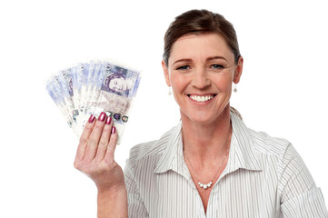 Business woman holding fan of currency notes