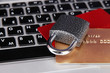 Credit cards and lock on keyboard close up