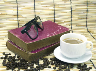 Old book and glasses on bamboo