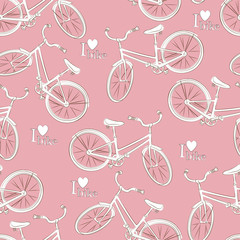 Seamless pattern with retro bicycle on pink background