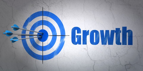 Finance concept: target and Growth on wall background