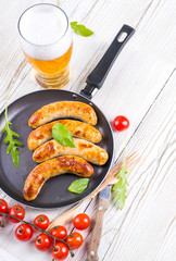 The Munich sausages with tomatoes and arugula