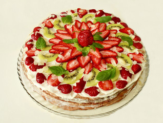 cake with cream filling covered with strawberries