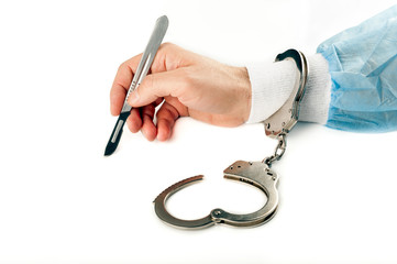 isolated one handcuffed surgeon lancet in hand on white