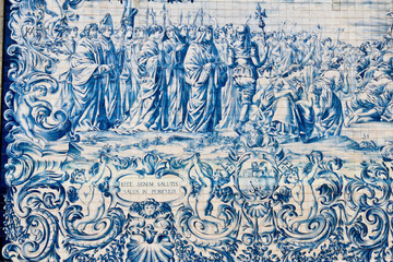 Painted tiles azulejos on the wall of a church in Porto