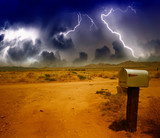 Classic mailbox on the road under a storm