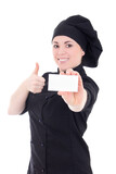 young baker woman in black uniform showing visiting card isolate