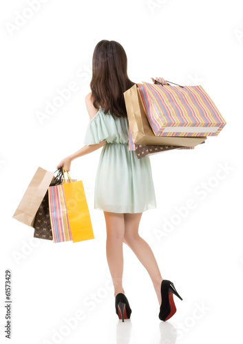 Rear view of Asian shopping woman