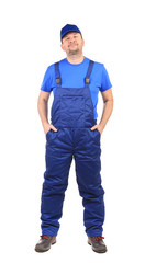 Worker with arms in pockets.