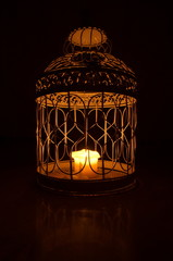 Candle in a cage