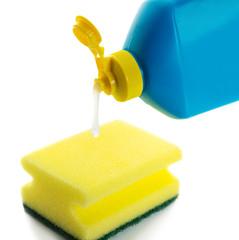 dishwashing liquid and sponge on white