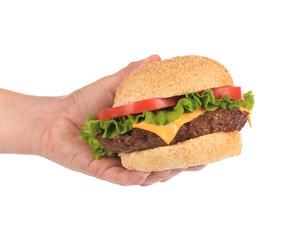 Big appetizing hamburger in hand.