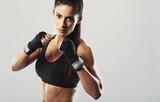 Female fighter posing in combat pose - 61574481