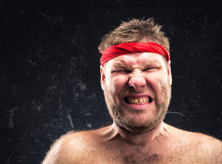 Angry man with red headband