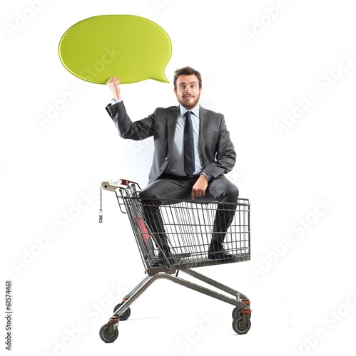 Message of a businessman with shopping cart