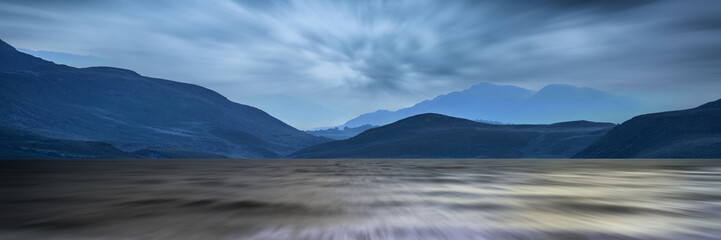 Long exposure panorama landscape of stormy sky and mountains  ov