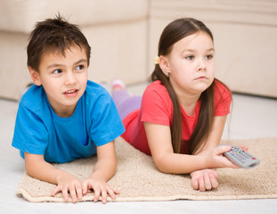 Girl and boy watching tv