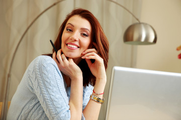 Smiling woman working at home