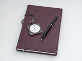 Retro pocket watch, diary and pen