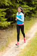 Woman jogging outdoor running countryside path
