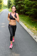 Sportive woman running outdoor motion blur