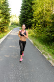 Athlete woman training for running race outdoor