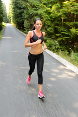 Woman running marathon race motion blur