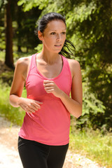 Jogging woman close-up running in countryside