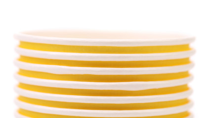 Pile of yellow paper coffee cup. Close up.