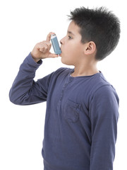 Child using asthma inhaler from side isolated on white