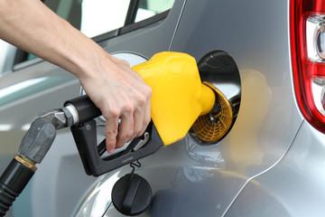 Close-up shot of a man holding a fuel pump