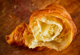 A delicious croissant on the wooden table