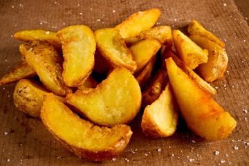 Salted fried potato on a cardboard