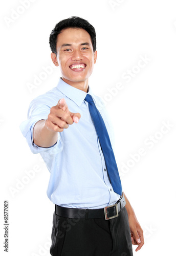 Poster Young businessman pointing his finger at you