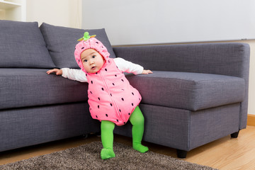Baby girl with strawberry costume