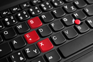 Sex sign highlighted in red on the laptop keyboard