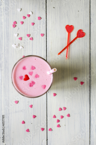 Pink milkshake sprinkled with sugar hearts