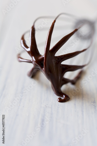 Chocolate-covered whisk macro. Abstract image.