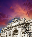Rome, Italy. Trevi fountain building facade at dusk