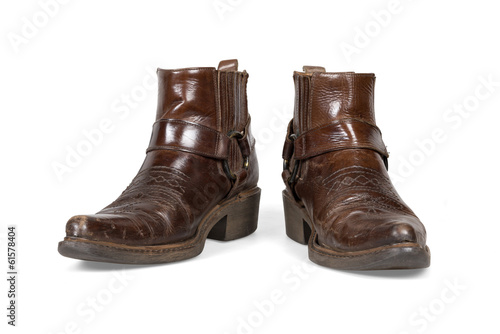 Old and worn cowboy boots isolated with clipping path.