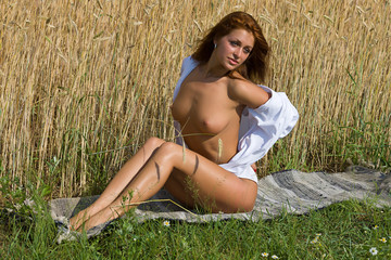 Nude girl in the field.