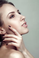 Glamour portrait of beautiful woman model with fresh clean skin