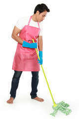 Portrait of young man with cleaning equipment