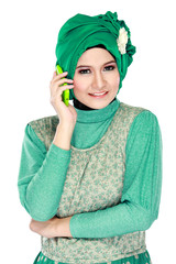 asian woman with head scarf calling by mobile phone