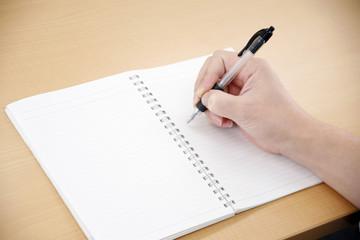 ノートと手