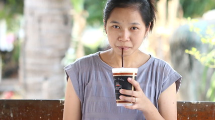 Woman drinking ice coffee