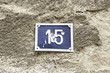 Number fifteen on a wall of a house