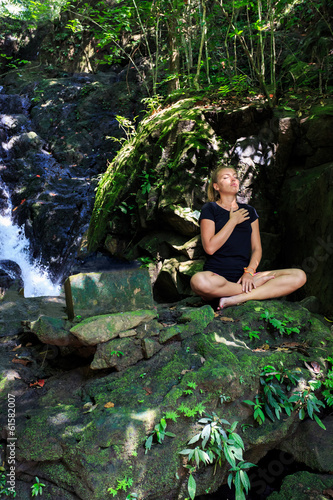 Young woman doing Meditating - 61582007