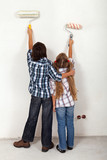 Kids painting the room in their new home
